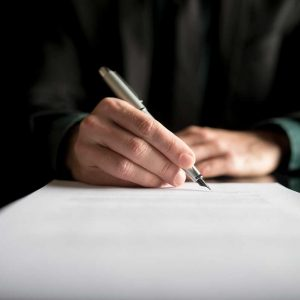 closeup-of-lawyer-or-executive-signing-a-contract-PK4B783
